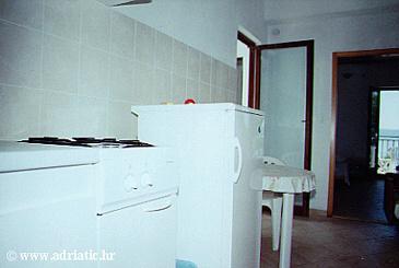 Marušići, Kitchen u smještaju tipa apartment.
