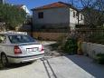 Parking lot Vinišće (Trogir) - Accommodation 11075 - Apartments with pebble beach.