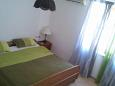 Bedroom 1 - Apartment A-11242-a - Apartments and Rooms Novigrad (Novigrad) - 11242