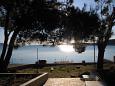Martinšćica, Cres, Courtyard 11279 - Apartments blizu mora with pebble beach.