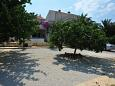 Parking lot Supetar (Brač) - Accommodation 11360 - Apartments near sea with pebble beach.