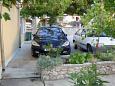 Tribunj, Vodice, Parking lot 11399 - Apartments with pebble beach.