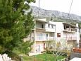 Property Stanići (Omiš) - Accommodation 11421 - Apartments with pebble beach.
