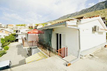 Property Dugi Rat (Omiš) - Accommodation 11483 - Apartments with pebble beach.