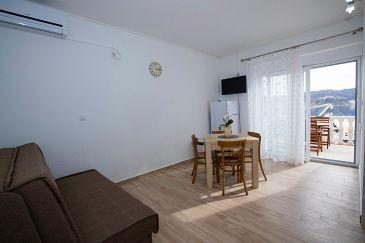 Supetarska Draga - Gornja, Dining room u smještaju tipa apartment, dostupna klima i WIFI.
