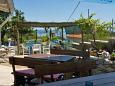 Beli, Cres, Courtyard 3048 - Rooms with pebble beach.