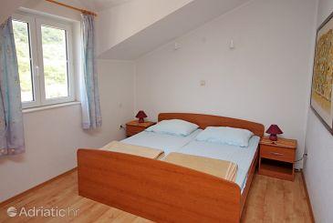 Saplunara, Bedroom u smještaju tipa room.