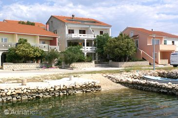 Kustići, Pag, Property 4086 - Apartments blizu mora with pebble beach.