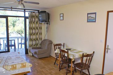 Lumbarda, Dining room u smještaju tipa studio-apartment.