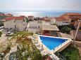 Duće, Omiš, Courtyard 4632 - Apartments and Rooms with sandy beach.