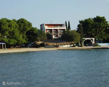 Property Pirovac (Šibenik) - Accommodation 488 - Apartments near sea with pebble beach.