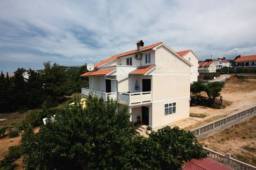 Property Barbat (Rab) - Accommodation 5001 - Apartments with pebble beach.