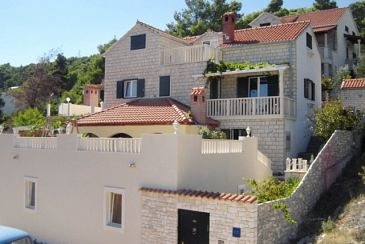 Property Postira (Brač) - Accommodation 5661 - Vacation Rentals with pebble beach.
