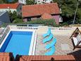 Courtyard Postira (Brač) - Accommodation 5661 - Vacation Rentals with pebble beach.