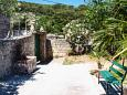 Courtyard Dol (Brač) - Accommodation 5674 - Vacation Rentals with pebble beach.