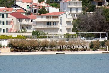 Property Marina (Trogir) - Accommodation 5968 - Apartments near sea with pebble beach.