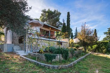 Property Postira (Brač) - Accommodation 6052 - Vacation Rentals with pebble beach.