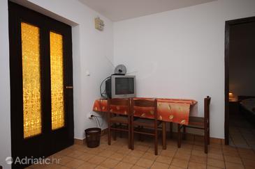 Stara Novalja, Dining room u smještaju tipa apartment.