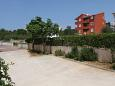 Parking lot Novalja (Pag) - Accommodation 6551 - Apartments with pebble beach.