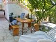 Courtyard Povljana (Pag) - Accommodation 6561 - Apartments near sea with sandy beach.