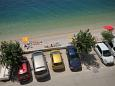Parking lot Podgora (Makarska) - Accommodation 6713 - Apartments near sea with pebble beach.