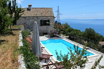 Property Brela - Krug (Makarska) - Accommodation 6916 - Vacation Rentals with pebble beach.