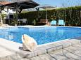Courtyard Valbandon (Fažana) - Accommodation 7346 - Apartments with pebble beach.
