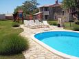 Courtyard Guran (Središnja Istra) - Accommodation 7373 - Vacation Rentals with pebble beach.