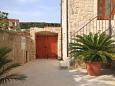 Courtyard Jelsa (Hvar) - Accommodation 8713 - Apartments with pebble beach.