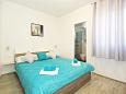 Bedroom - Apartment A-8761-e - Apartments Uvala Zastupac (Hvar) - 8761