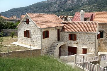 Property Komiža (Vis) - Accommodation 9247 - Apartments with pebble beach.