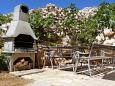 Courtyard Vidalići (Pag) - Accommodation 9393 - Apartments with pebble beach.