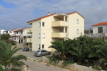 Property Novalja (Pag) - Accommodation 9417 - Apartments with pebble beach.